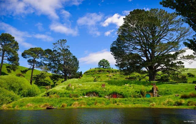 Image of the set of Hobbiton found in Matamata - you can see the hobbit houses in the side of the hill