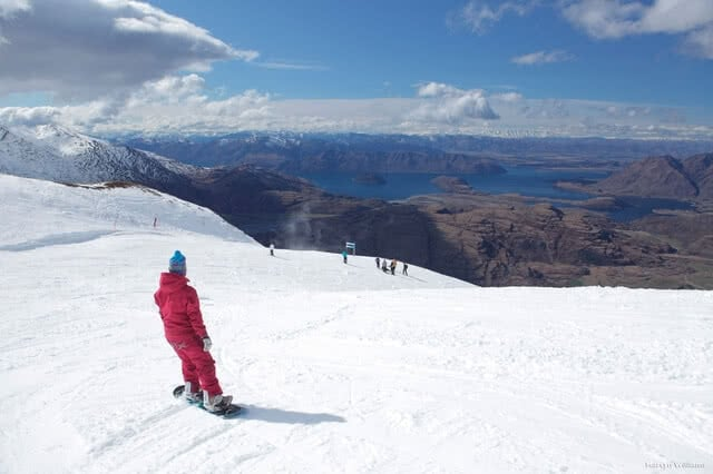 Image of a snowboarder on the ski fields above Queenstown, New Zealand